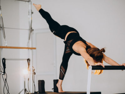 Woman doing pilates on a reformer